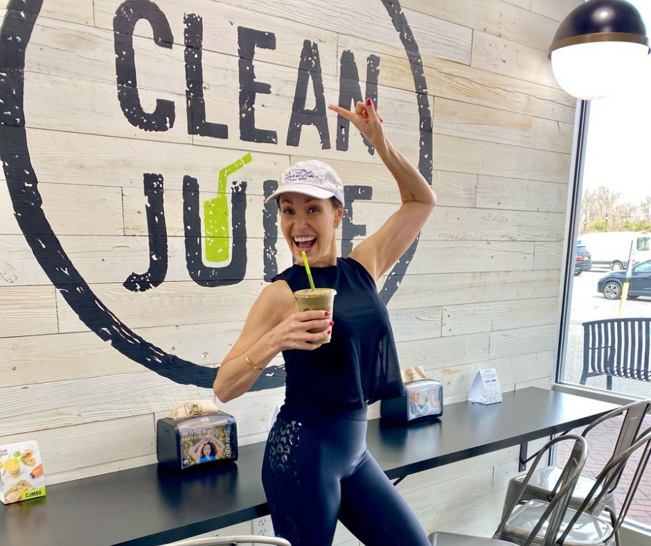 Audrey Zona holding the Zo Healthy Smoothie in Clean Juice Wyckoff